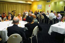 Members and guests at a dinner venue